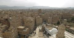 Stock Video Footage of Panoramic Cityscape of the Alfulihi neighborhood in old Sana'a, Yemen (4K)