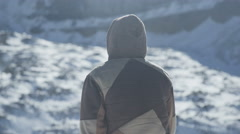 A man stands thinking about his trek through the mountains Stock Footage