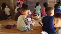 Children doing their homeworks, Burma Stock Footage