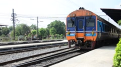 Train on railway at Bangpa-in Station in Ayutthaya Thailand Stock Footage