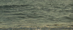 Ocean at sunset in slow motion, anamorphic - stock footage
