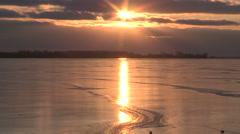 Sun reflecting of the ice on a frozen lake Ontario at Toronto. Stock Footage