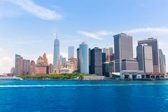 lower manhattan skyline new york from bay usa - stock photo