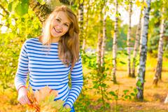 happy expectant mother walks in autumn park - stock photo