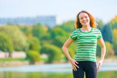 portrait of cheerful red-haired girl in a green t-shirt - stock photo