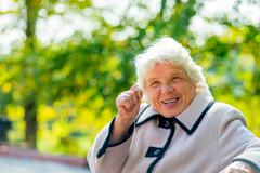 an elderly woman of 80 years shows a fig - stock photo