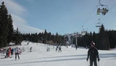 People skiing on slope at winter. Skiers riding on ski lift. Downhill. Mountain. Stock Footage