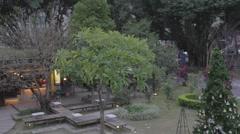 Huanshan park - aerial pan trio restaurant Stock Footage
