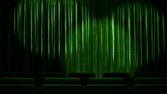 Loop light on green fabric curtain Stock Footage