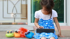 Little girls play with with tablet Stock Footage