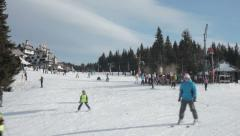 People skiing on slope. Skiers descending down the slope. White. Snow. Winter. Stock Footage