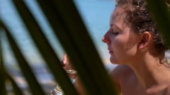 Thirsty Woman Drinking Water on Tropical Beach. Slow Motion. Stock Footage