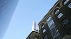 the shard london reflecting in windows of building - stock footage