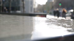 More london riverside water installation with traffic background Stock Footage