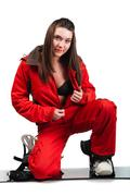 Attractive girl unfastens one's clothes. red sports jacket and snowboard Stock Photos