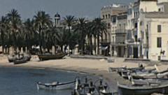 Sitges 1950s: boat docking in front of the Sea Stock Footage