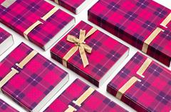 Background from small cardboard red boxes gifts Stock Photos