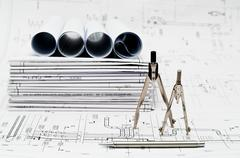 Stock Photo of Construction paper blueprints and drawing tools