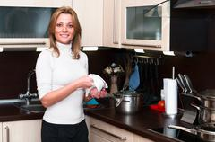 Beautiful happy smiling woman in kitchen interior. one person only Stock Photos