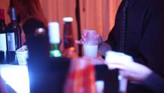 Bartenders preparing drinks for people at night time event close up Stock Footage