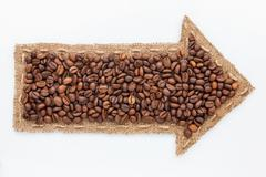 Pointer with coffee  grains Stock Photos