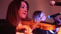 Violinist woman playing violin and singing in concert 4 Stock Footage
