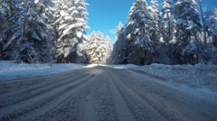 Driving on snow road. Snow road to a sunny day. - stock footage