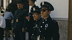 Sitges 1950s: fascist policemen in the old town Stock Footage