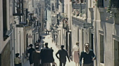 Sitges 1950s: people walking in the old town - stock footage