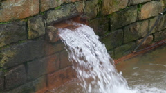 Hot Spring Water Flow from Pipe on Wall Stock Footage