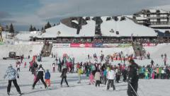 People skiing on slope. Skiers descending down the slope. Crowd. Mountain.Winter Stock Footage