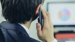 Man managing business on the phone Stock Footage