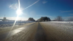 Driving in a fine sunny day, on snow-covered road. - stock footage
