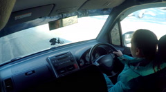 Car movement. The girl operates the car on winter road. Stock Footage