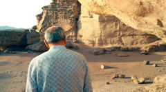 A man looking up at gorgeous cliffs, close shooting Stock Footage
