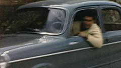 Italy 1950s: car driving in the street Stock Footage