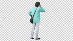 Male in the green shirt talking by phone (back view) Stock Footage