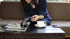 Asian beautiful woman sitting in coffee shop. Reading a book Stock Footage