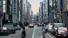 Zoom Out of Crosswalk in Busy Ginza Shopping District - Tokyo Japan Stock Footage