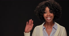 Young African American black woman waving hand smile face Stock Footage