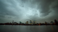 Stock Video Footage of Business capital Canary Wharf and the river Thames in London.