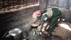 Africa village woman cooking Guinea Bisseau close up Stock Footage