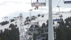 Skiers riding on ski lift. People on ropeway. Chairlift. Gondola lift. Cable car Stock Footage