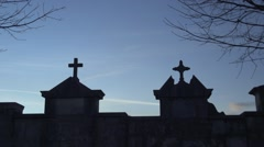 Two Christian cross in the cemetery with sky background birds pass Stock Footage