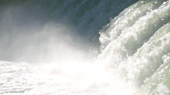 Water from the large waterfall crashes and splash rise in the air slow motion - stock footage