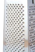 Detailed view of metal grater on white background - stock photo
