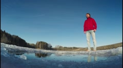 Man in the ice hole Stock Footage