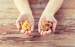 Female hands with different pasta variations Stock Photos