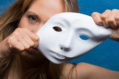 angry woman using a mask - stock photo