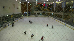 Juniors training ice hockey in mall Stock Footage